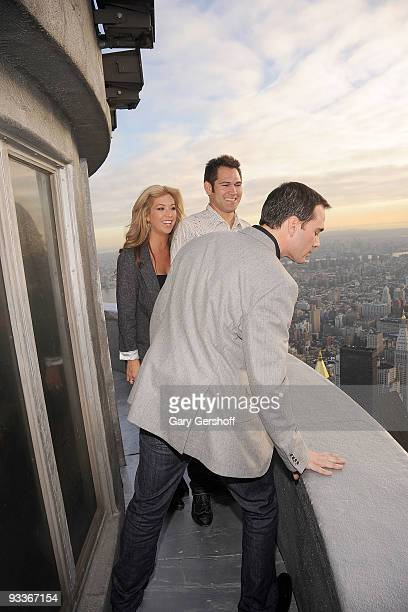 Michelle Mangan Damon husband New York Yankee Johnny Damon and NASCAR championship driver Jimmie Johnson check out the view from the uppermost level...