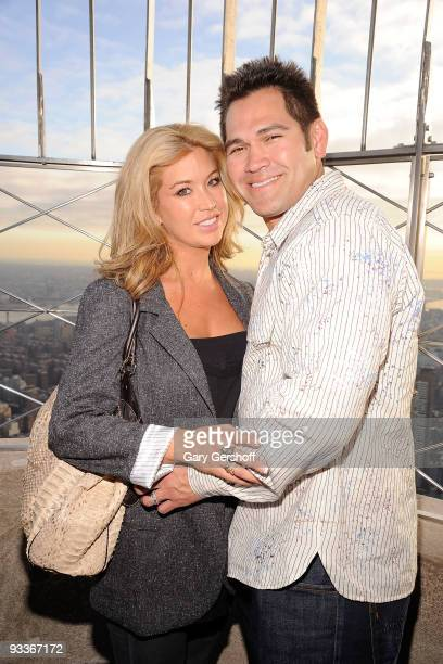 Michelle ManganDamon and husband New York Yankee Johnny Damon pose for pictures on the Empire State Building Observation Deck in celebration of...