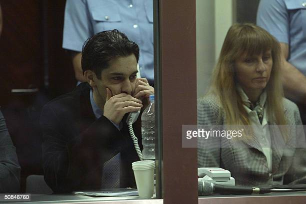 Michelle Martin exwife of the accused Marc Dutroux and Michel Lelievre sit in the dock during the trial of Marc Dutroux at Arlon's courthouse 17 May...