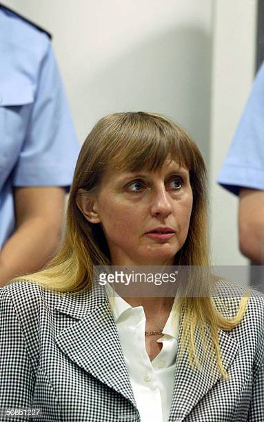 Michelle Martin exwife of the accused Marc Dutroux sits in the dock during the trial of Belgian pedophile Marc Dutroux at Arlon's courthouse 18 May...