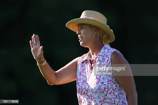 Michelle McGann of the United States waves to fans on the 12th fairway during the second round of the U.S. Senior Women's Open Championship on July...
