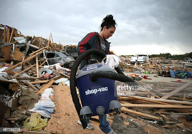 Michelle McGee removes belonings from her home that was destroyed by a tornado on Sunday, April 29, 2014 in Vilonia, Arkansas. After deadly tornadoes...