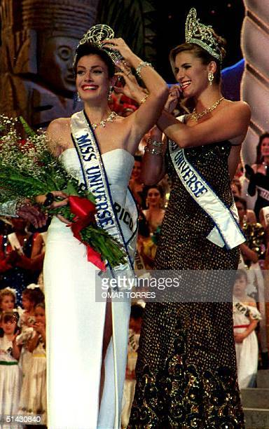 Michelle McLean Miss Universe 1992 of Namibia puts the crown on Dayanara Torres of Puerto Rico the new Miss Universe on March 24