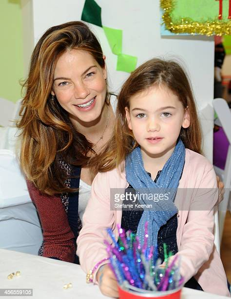 Michelle Monaghan and daughter Willow attend the Third Annual Baby2Baby Holiday Party presented by The Honest Company on December 14 2013 in Los...