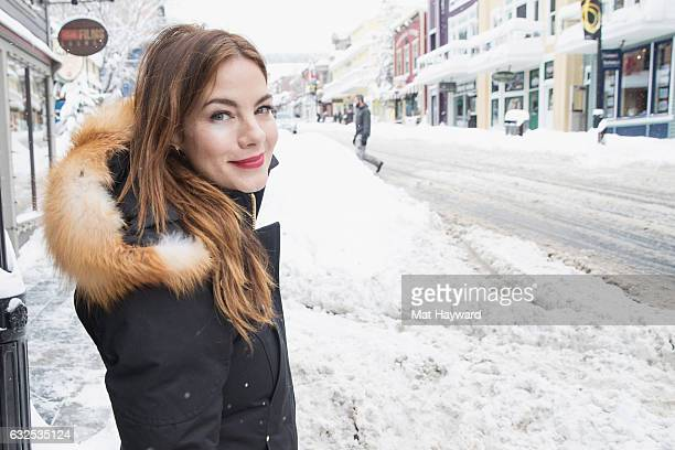 Michelle Monaghan poses for a photo on a snow covered Main street during the Sundance Film Festival on January 23 2017 in Park City Utah