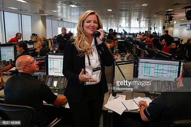 Michelle Mone founder of Ultimo Ltd makes a trade for charity on the trading floor during a charity day at BGC Brokers LP a unit of BGC Partners Inc...