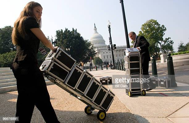 Michelle Moody and her father Kevin Moody deliver Vaultz boxes to the members of the Senate Commerce Science and Transportation Committee on Thursday...