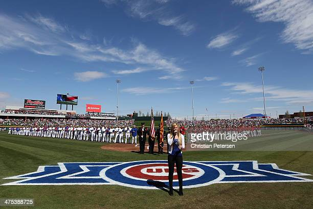 Michelle Moyer performs the National Anthem before the spring training game between the Chicago Cubs and the Arizona Diamondbacks at Cubs Park on...