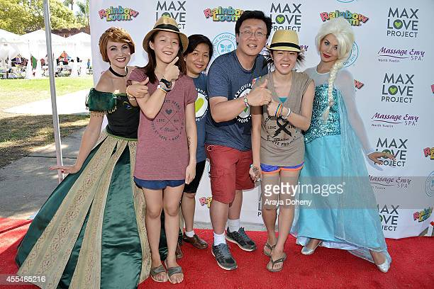 Michelle Ng Fen Chan Cheong Choon Ng and Teresa Ng attends the MaxLove LoomAThon 2 with Melissa Joan Hart on September 14 2014 in Tustin California