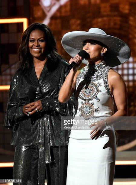 Michelle Obama and Jennifer Lopez speak onstage during the 61st Annual GRAMMY Awards at Staples Center on February 10 2019 in Los Angeles California