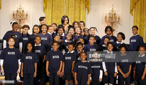 Michelle Obama and the Myrtilla Miner Elementary School Glee Club attend the White Houses Governors Ball talent preview at the White House on...