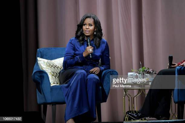 Michelle Obama discusses her new book 'Becoming' with Michelle Norris in front of a sold out audience of more than 20000 people at TD Garden on...