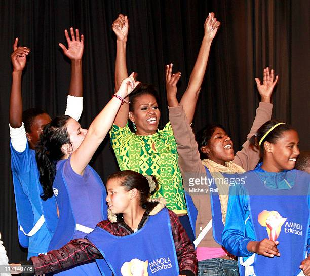 Michelle Obama, first lady of the United States of America celebrates with children at a Youth Soccer Event where she spoke about HIV/AIDS prevention...