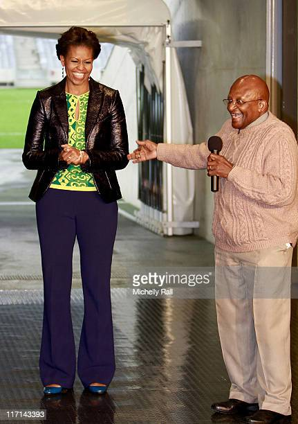 Michelle Obama, first lady of the United States of America shares a joke with Nobel Prize Peace Laureate, Archbishop Desmond Tutu, as they attend a...