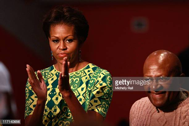 Michelle Obama, first lady of the United States of America stands next to Nobel Prize Peace Laureate, Archbishop Desmond Tutu, as they attend a Youth...
