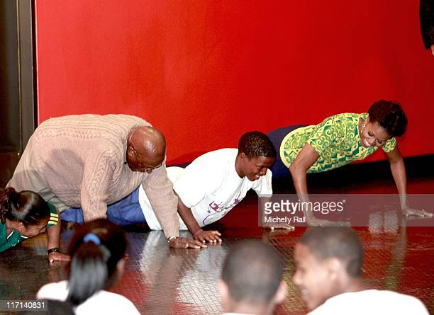 Michelle Obama, first lady of the United States of America takes part in a push up competition next to Nobel Prize Peace Laureate, Archbishop Desmond...