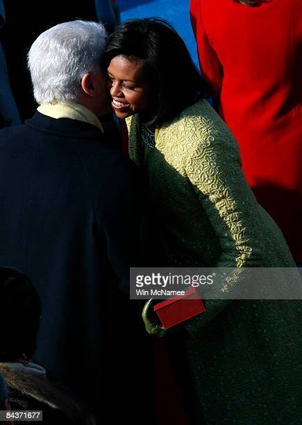 Michelle Obama greets former president Bill Clinton as she arrives at the inauguration of Barack Obama as the 44th President of the United States of...