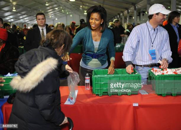 Michelle Obama helps volunteers with Operation Gratitude on National Service Day January 19 2009 at RFK Stadium in Washington DC Operation Gratitude...