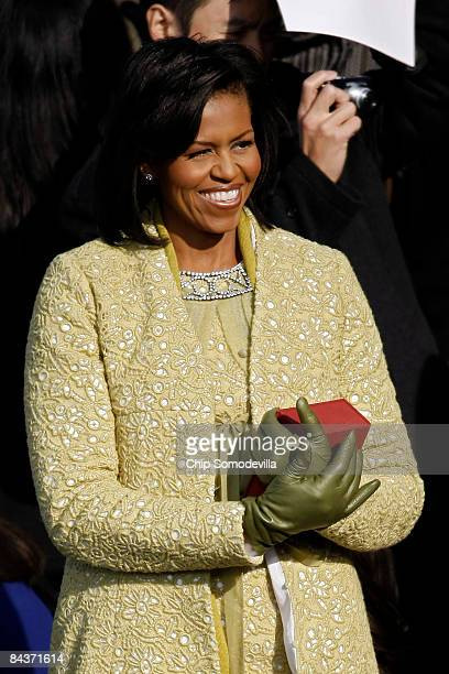 Michelle Obama holds the Lincoln bible as she arrives at the inauguration of Barack Obama as the 44th President of the United States of America on...