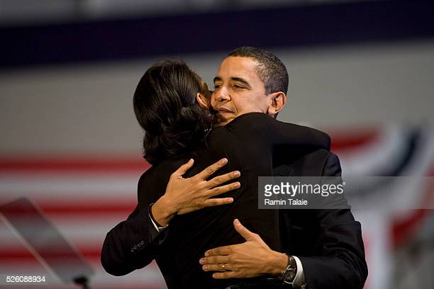 Michelle Obama hugs her husband, Democratic presidential hopeful Senator Barack Obama, during a rally at the Nashua South High School. Obama conceded...