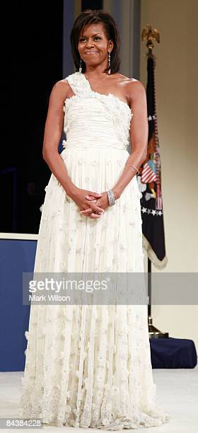 Michelle Obama looks on as President Barack Obama speaks at the MidAtlantic Inaugural Ball at the Washington Convention Center on January 20 2009 in...