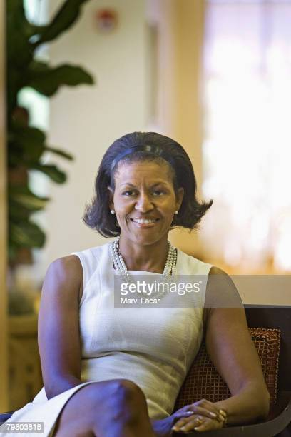 Michelle Obama poses at a portrait session