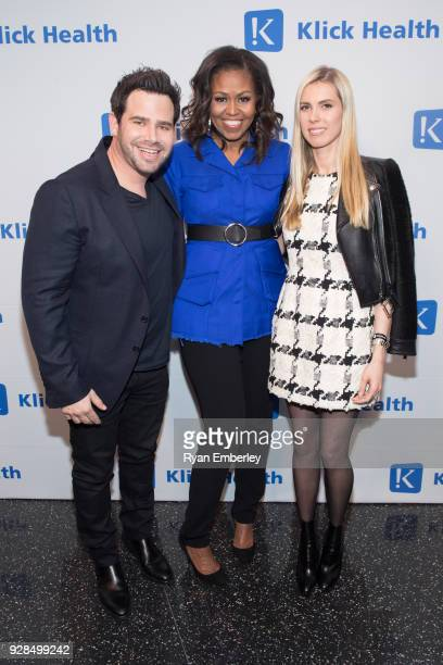 Michelle Obama poses with Klick Health CEO Leerom Segal and Karolina Segal attennd MUSE New York 2018 at One World Observatory on February 27 2018 in...