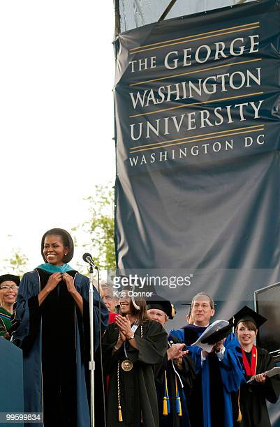 Michelle Obama recieves a honorary doctorate in Public Service during the 2010 George Washington University commencement at the National Mall on May...