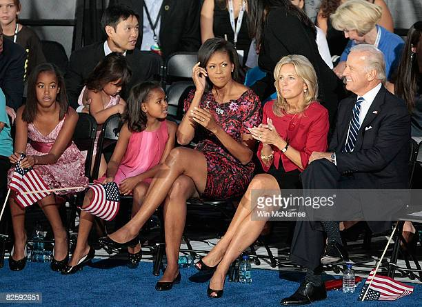Michelle Obama, wife of Democratic U.S. Presidential nominee Sen. Barack Obama , sits with her kids and Democratic U.S. Vice-Presidential nominee Joe...