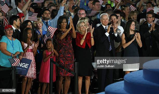 Michelle Obama, wife of Democratic U.S. Presidential nominee Sen. Barack Obama , applauds with and Democratic U.S. Vice-Presidential nominee Joe...
