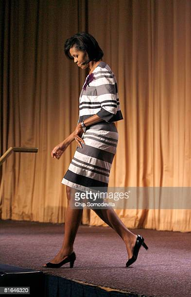 Michelle Obama wife of presumed Democratic presidential candidate Sen Barack Obama steps off the stage after addressing about 900 people at the...