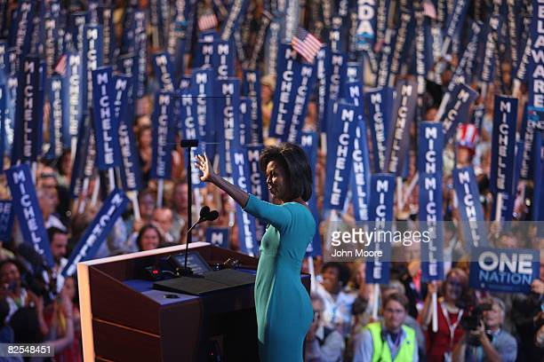 Michelle Obama wife of presumptive Democratic nominee US Sen Barack Obama waves to the crowd during day one of the Democratic National Convention at...