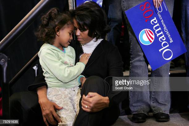 Michelle Obama, wife of Senator Barack Obama , shares a moment with her daughter Sasha as the Senator addresses a crowd gathered at a campaign rally...