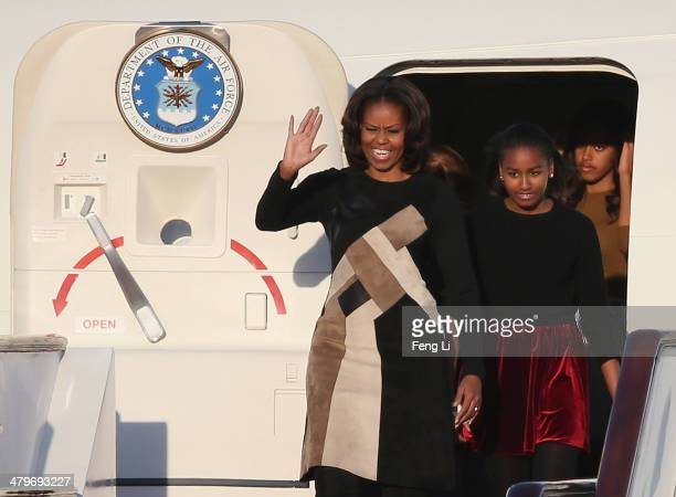 Michelle Obama with her daughters Sasha Obama and Malia Obama arrives at Beijing Capital International Airport on March 20 2014 in Beijing China The...
