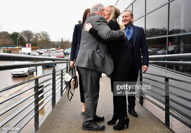 Michelle O'Neill leader of Sinn Fein in Northern Ireland hugs Francie Molloy as they arrive at the Seven Towers Leisure Centre for the North Antrim...