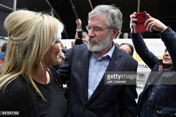Michelle O'Neill leader of Sinn Fein in Northern Ireland is greeted by Sinn Fein president Gerry Adams as she arrived at the count for the Northern...