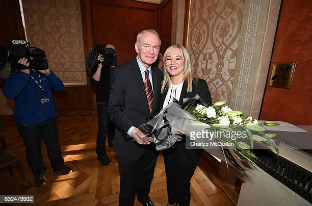 Michelle O'Neill the new Sinn Fein leader in the north is presented with flowers by Martin McGuinness at a Stormont press conference on January 23...