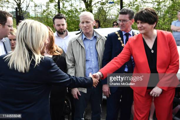 Michelle O'Neill, Vice President of Sinn Fein and Arlene Foster, leader of the DUP shake hands as they attend a rally for journalist and author Lyra...