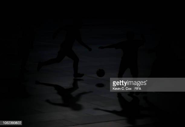 Michelle Pacheco and Maria Galvez of Bolivia controls the ball against Spain in the Women's Futsal 3rd Place match between Bolivia and Spain during...