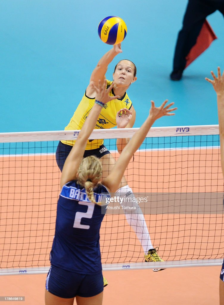 Michelle Pavao of Brazil spikes the ball during day three of the FIVB World Grand Prix Sapporo 2013 match between Brazil and Italy at Hokkaido Prefectural Sports Center on August 30, 2013 in Sapporo, Hokkaido, Japan.