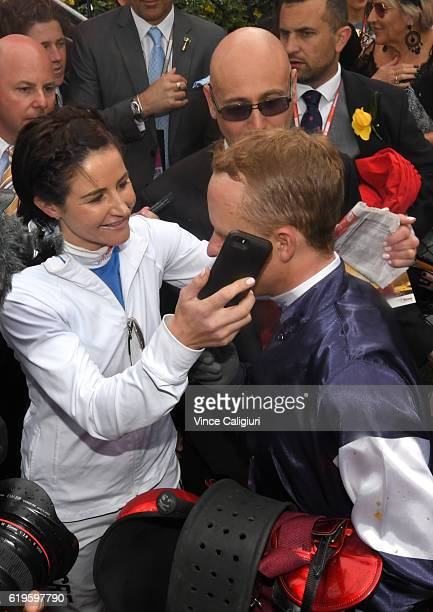 Michelle Payne hands the phone with his wife Cathy Payne speaking after Kerrin McEvoy rode Almandin to win Race 7 the Emirates Melbourne Cup on...