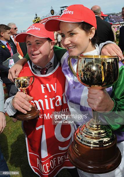Michelle Payne hugs brother Stephen Payne and poses with the trophy after riding Prince of Penzance to win race 7 the Emirates Melbourne Cup on...