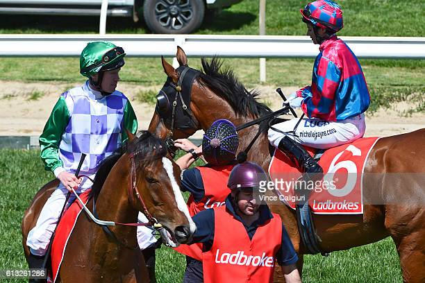 Michelle Payne riding Dandy Gent waiting at the barrier start beside John Allen riding Prince of Penzance in Race 2 Herbert Power Stakes during...