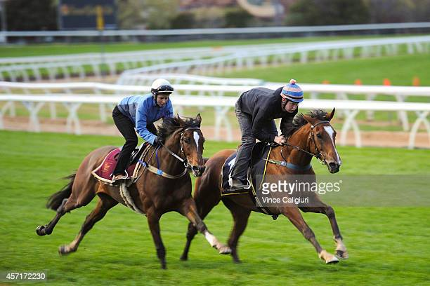 Michelle Payne riding Kingdoms and Reece Cole riding Rising Romance during a trackwork session at Caulfield Racecourse on October 14 2014 in...