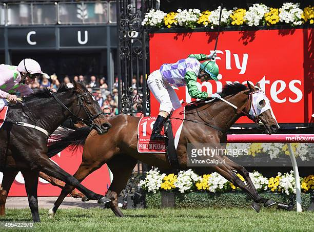 Michelle Payne riding Prince of Penzance defeats Frankie Dettori riding Max Dynamite in race 7 the Emirates Melbourne Cup on Melbourne Cup Day at...