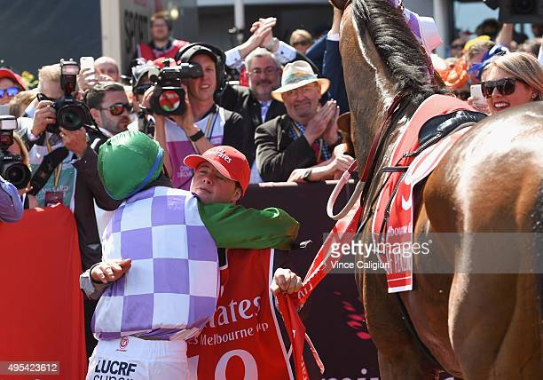 Michelle Payne riding Prince of Penzance hugs brother Stephen Payne after winning race 7 the Emirates Melbourne Cup on Melbourne Cup Day at...