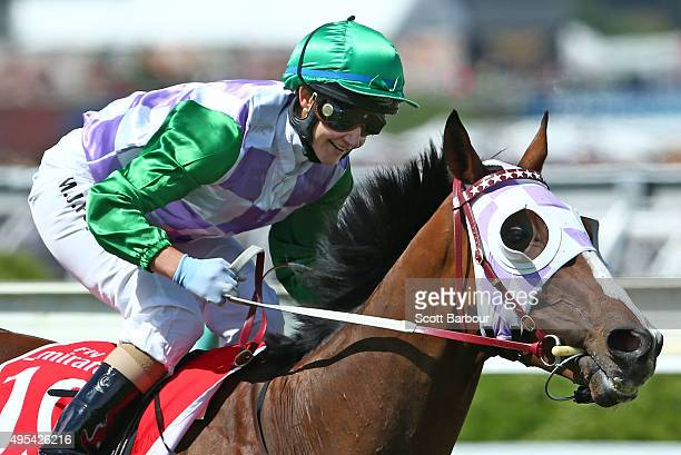 Michelle Payne riding Prince Of Penzance smiles as she rounds the bend after winning race 7 the Emirates Melbourne Cup on Melbourne Cup Day at...