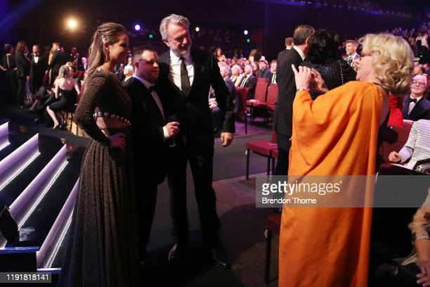 Michelle Payne Stevie Payne and Sam Neill pose as Laura Tingle takes a photo during the 2019 AACTA Awards Presented by Foxtel at The Star on December...