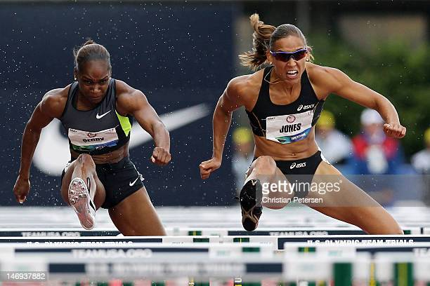 Michelle Perry and Lolo Jones compete in the women's 100 meter hurdles semifinal during Day Two of the 2012 US Olympic Track Field Team Trials at...