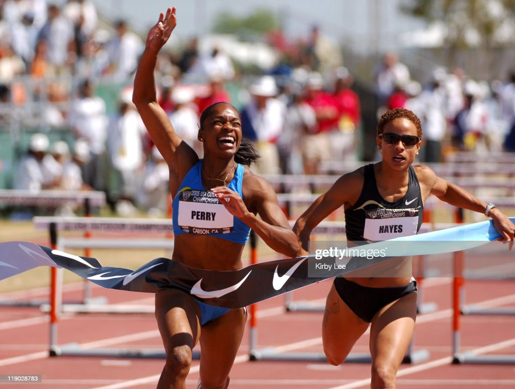 Michelle Perry celebrates after defeating Joanna Hayes to win the women's 100-meter hurdles, 12.66 to 12.77, in the USA Track & Field Championships at the Home Depot Center in Carson, Calif. on Sunday, June 26, 2005.